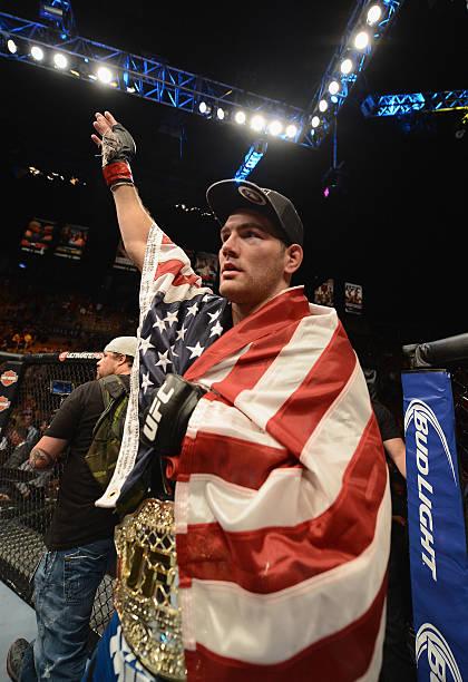 UFC middleweight champion Chris Weidman retains his...