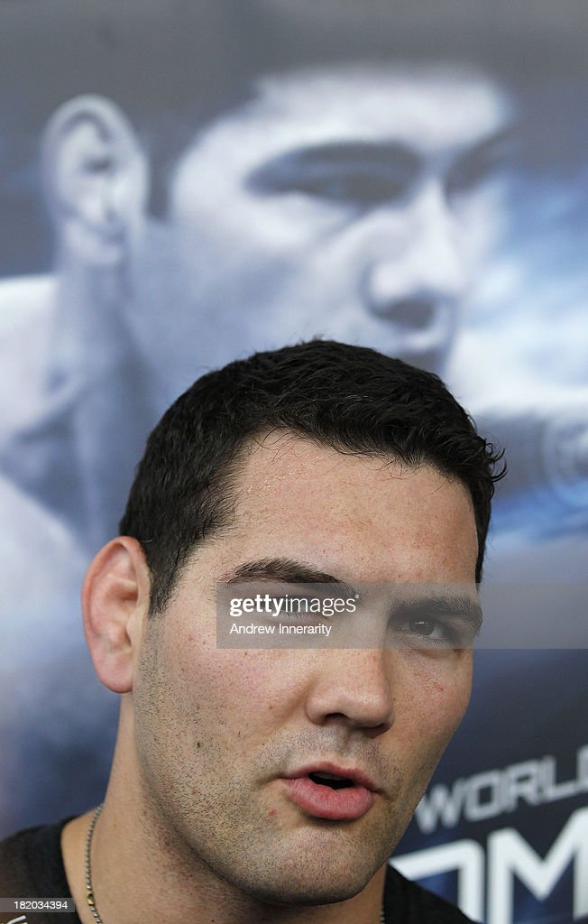 UFC middleweight champion Chris Weidman talks to the media during the UFC 168: Weidman v SIlva 2 press tour at Klipsch Amphitheater at Bayfront Park on September 27, 2013 in Miami, Florida.