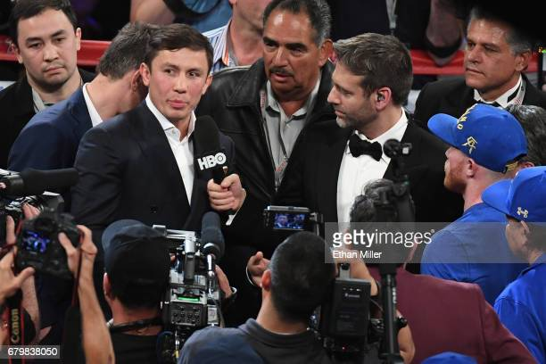 WBC/WBA/IBF middleweight champion Gennady Golovkin is interviewed in the ring by boxing commentator Max Kellerman as Canelo Alvarez looks on after...