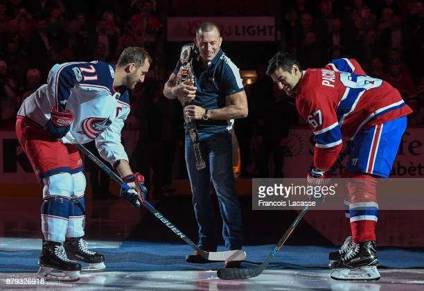 UFC middleweight champion George StPierre receives homage prior to the NHL game of the Montreal Canadiens and the Columbus Blue Jackets at the Bell...