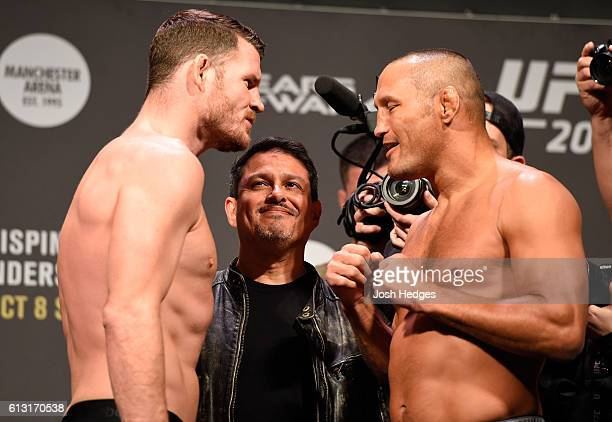 Middleweight champion Michael Bisping and Dan Henderson of the United States face-off during the UFC 204 weigh-in at the Manchester Central...