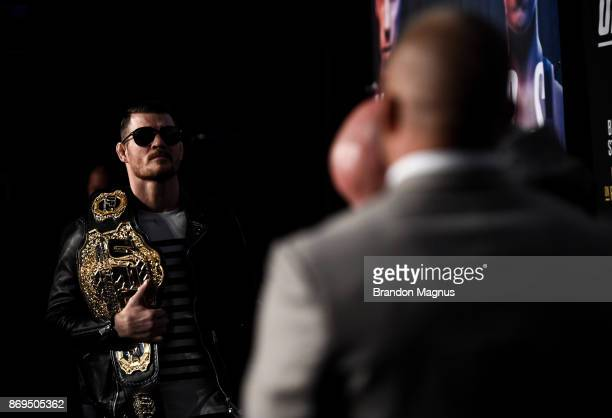 UFC middleweight champion Michael Bisping of England and Georges StPierre of Canada face off during the UFC 217 Press Conference inside Madison...