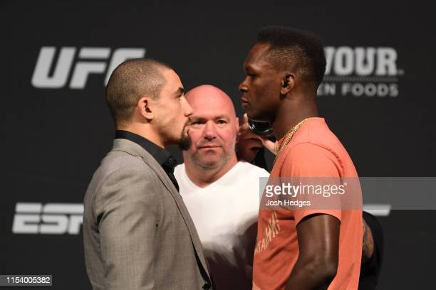UFC middleweight champion Robert Whittaker of Australia and UFC interim middleweight champion Israel Adesanya of New Zealand face off during the UFC...
