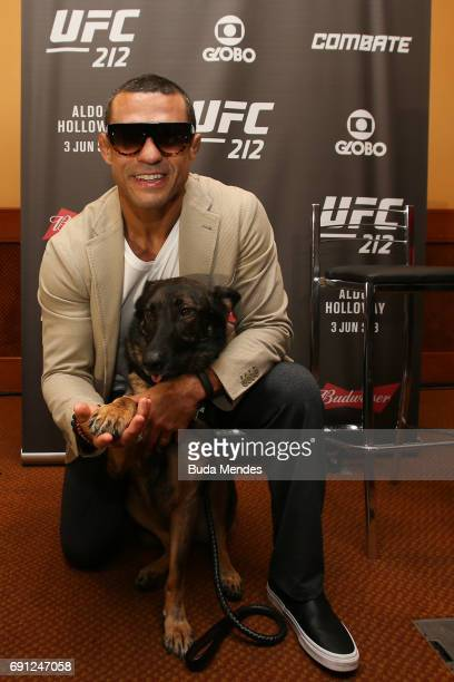 Middleweight contender Vitor Belfort of Brazil pose for photographers with his service dog during Ultimate Media Day at Windsor Hotel on June 01 2017...