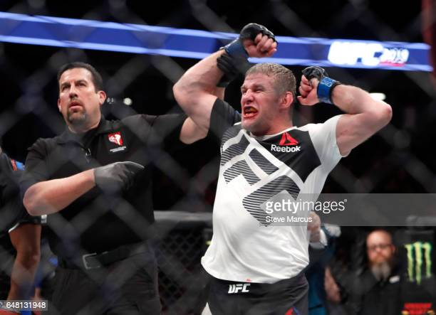Middleweight Daniel Kelly of Australia celebrates as he is declared the winner by split decision over Rashan Evans during UFC 209 at TMobile Arena on...