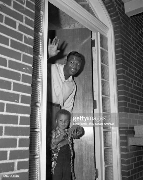Middleweight King Sugar Ray Robinson and little Ray Jr look pretty pleased and relaxed in doorway of the new Robinson home in Riverdale NY Getting...