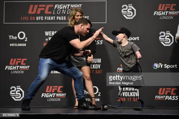 UFC middleweight Michael Bisping interacts with UFC fan Marshall Jensen during a QA session after the UFC Fight Night weighin inside The O2 Arena on...