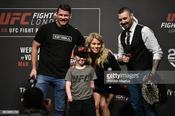 UFC middleweight Michael Bisping UFC fan Marshall Jensen UFC women's flyweight Paige VanZant and UFC commentator Dan Hardy pose for a photo during a...