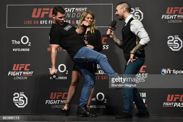 UFC middleweight Michael Bisping UFC women's flyweight Paige VanZant and UFC commentator Dan Hardy interact with fans during a QA session after the...