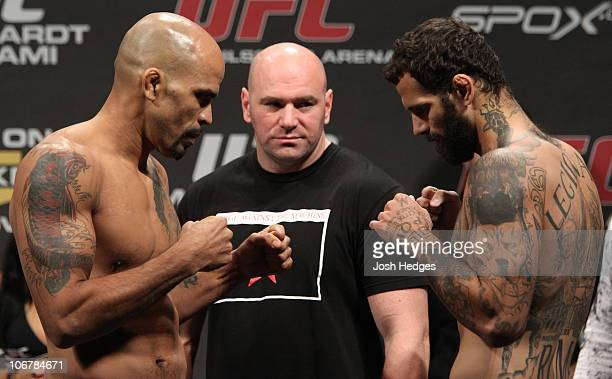 Middleweight opponents Jorge Rivera of United States and Alessio Sakara of Italy face off as UFC President Dana White looks on at the UFC 122 weighin...