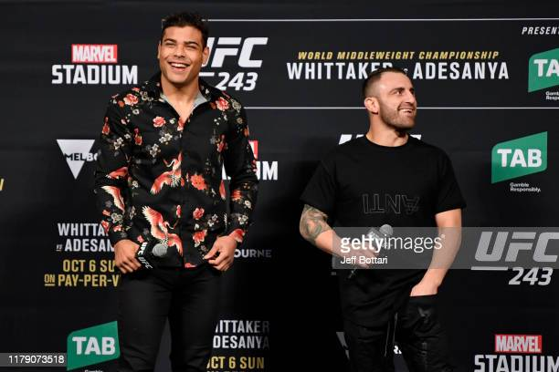 UFC middleweight Paulo Costa and UFC featherweight Alex Volkanovski stand on stage during a QA session after the UFC 243 weighin at Marvel Stadium on...