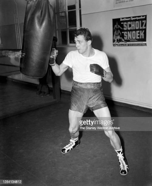 Middleweight professional boxer Gustav Bubi Scholz of Germany hits the punching bag while training circa 1954 at Stillman's Gym in New York New York