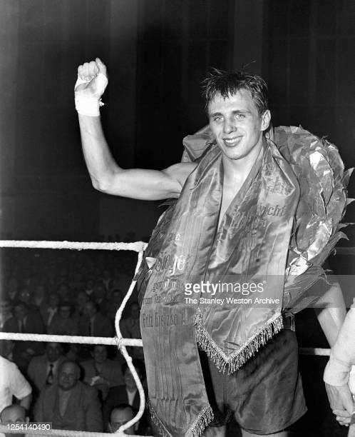 Middleweight professional boxer Gustav Bubi Scholz of Germany smiles after defeating his countryman Walter Schneider on May 19 1951 in Berlin Germany...