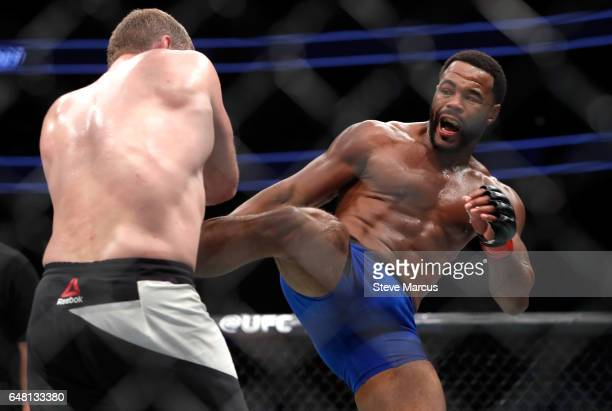 Middleweight Rashad Evans kicks Daniel Kelly of Australia during UFC 209 at TMobile Arena on March 4 2017 in Las Vegas Nevada Kelly won the fight by...