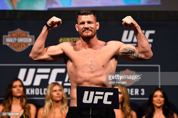Middleweight title challenger Michael Bisping of England steps on the scale during the UFC 199 weigh-in at the Forum on June 3, 2016 in Inglewood,...