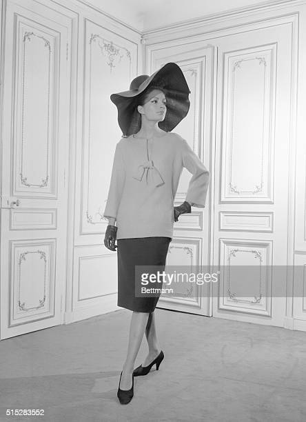 Pierre Cardin turns the classroom middy blouse into a chic knucklelength variation to top a slender skirt The Paris designer pinches daringly lowcut...