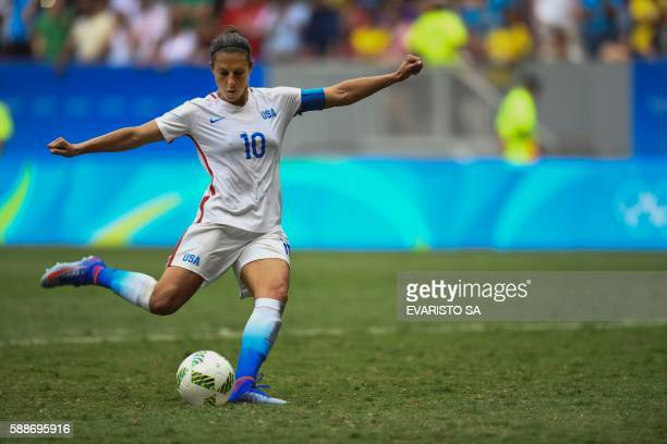 US' midfield Carli Lloyd kicks a penalty during the Rio 2016 Olympic Games Quarterfinals women's football match USA vs Sweden at the Mane Garrincha...