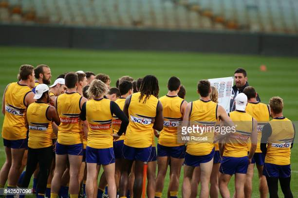 Midfield coach Dean Cox speaks to the team during a West Coast Eagles AFL training session at Domain Stadium on September 4 2017 in Perth Australia