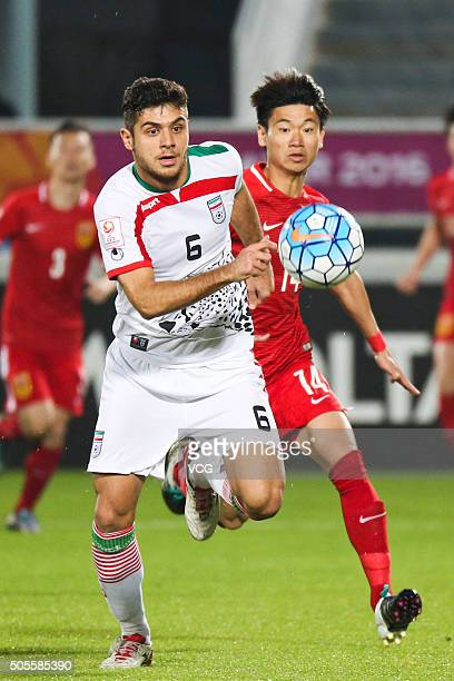Midfield Feng Gang of China defends against midfield Mahan Rahmani of Iran during the AFC U23 Championship Group A match between China and Iran at...