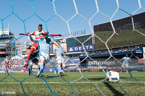 Midfield Thomas McNamara of New York City FC scores a goal during the New England Revolution match at Yankee Stadium on March 26 2016 in the Bronx...
