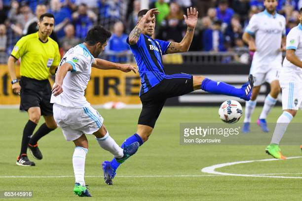 Midfielder Adrian Arregui trying to stop a shot from Midfielder Nicolas Lodeiro during the Seattle Sounders FC versus the Montreal Impact game on...