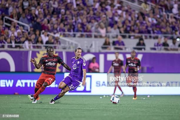 Midfielder Adrian Winter of Orlando City SC pushes a ball past Diego Chara the Portland Timbers at the Citrus Bowl on April 3 2016 in Orlando Florida