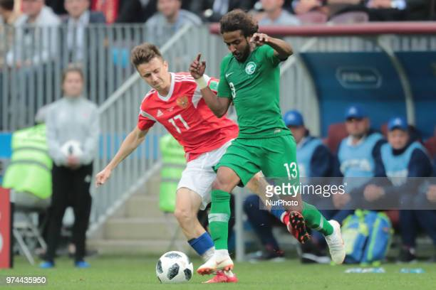 Midfielder Aleksandr Golovin of Russia National team and defender Yasir Alshahrani of Saudi Arabia National team during the Group A match between...