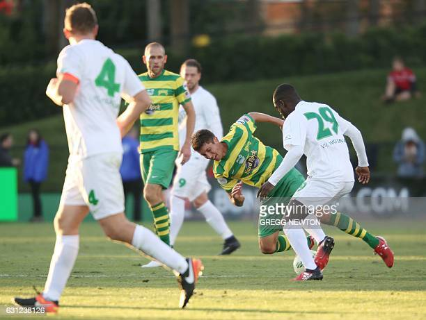 Midfielder Alex Morrell of the Tampa Bay Rowdies is stripped of the ball by midfielder Amara Conde of German club VFL Wolfsburg during the first half...