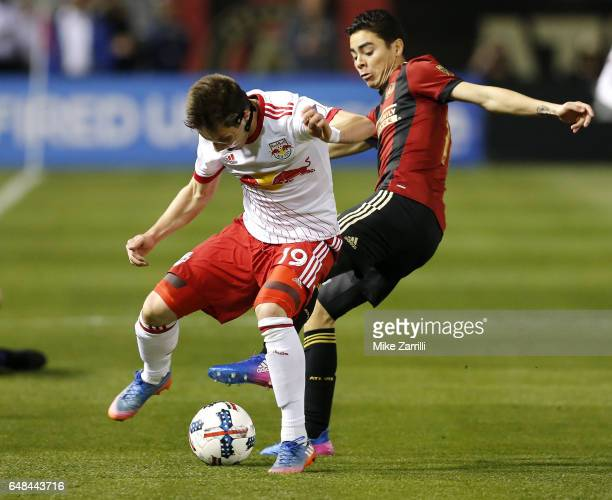 Midfielder Alex Muyl of the New York Red Bulls battles for the ball with midfielder Miguel Almiron of Atlanta United during the game at Bobby Dodd...