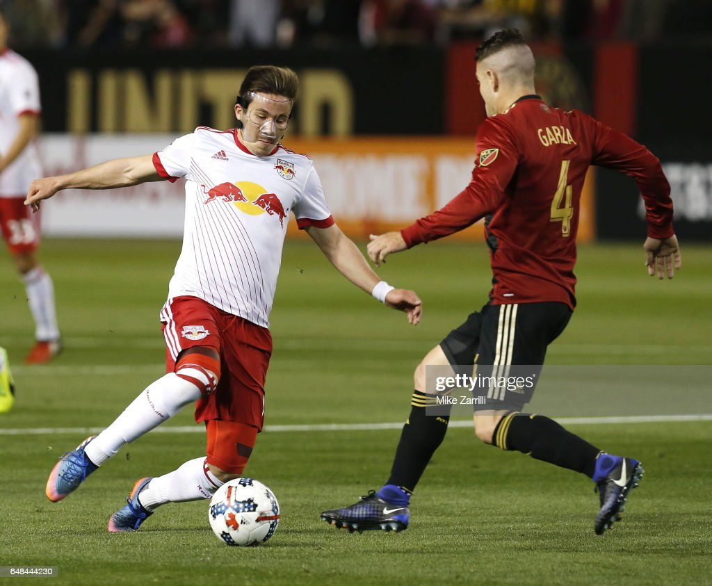 Midfielder Alex Muyl #19 of the New York Red Bulls dribbles in front of defender Greg Garza #4 of Atlanta United during the game at Bobby Dodd Stadium on March 5, 2017 in Atlanta, Georgia.