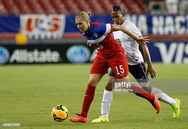 Midfielder Allie Long of the United States defends the ball from forward Marie Laure Delie of France during the second half of a women's friendly...