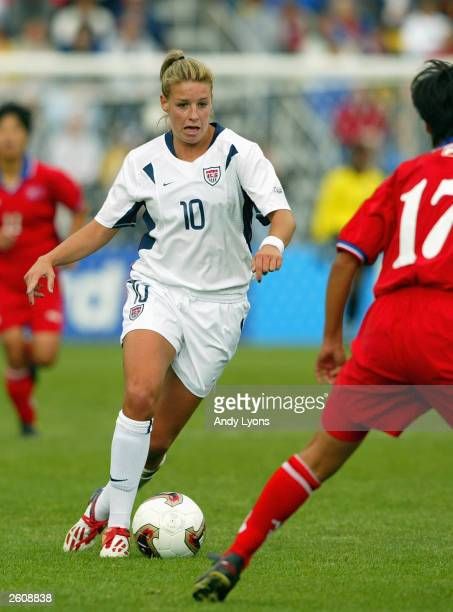 Midfielder Aly Wager of the USA dribbles the ball against North Korea during the 2003 FIFA Women's World Cup at Crew Stadium on September 28, 2003 in...