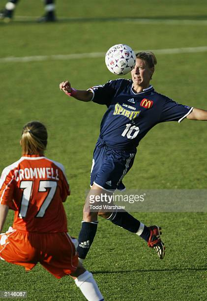 Midfielder Aly Wagner of the San Diego Spirit attempts to stop the ball while being pressured by defender Amanda Cromwell of the San Jose CyberRays...