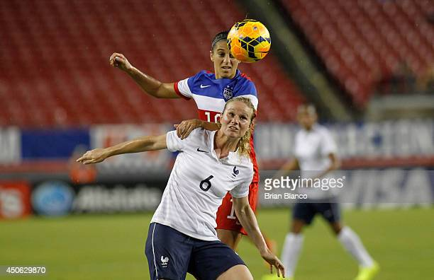 Midfielder Amandine Henry of France controls the ball against midfielder Carli Lloyd of the United States during the first half of a women's friendly...