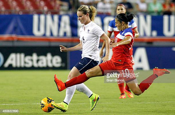 Midfielder Amandine Henry of France defends the ball from midfielder Carli Lloyd of the United States during the second half of a women's friendly...