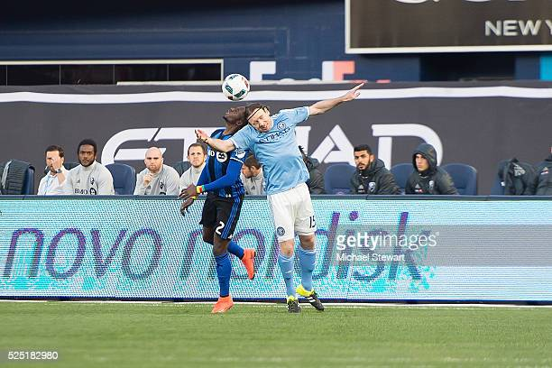 Midfielder Ambroise Oyongo of Montreal Impact and midfielder Thomas McNamara of New York City FC head the ball during the match at Yankee Stadium on...