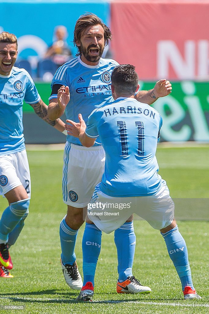 Midfielder Andrea Pirlo #21 of New York City FC and midfielder Jack Harrison #11 of New York City FC celebrate after a goal during the match vs Philadelphia Union at Yankee Stadium on June 18, 2016 in New York City. New York City FC defeats Philadelphia Union 3-2.