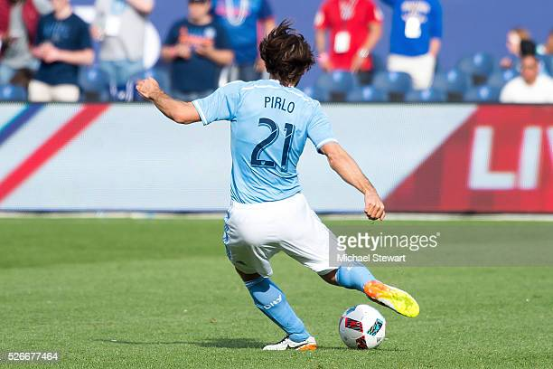 Midfielder Andrea Pirlo of New York City FC kicks the ball forward during the match vs Vancouver Whitecaps at Yankee Stadium on April 30 2016 in New...
