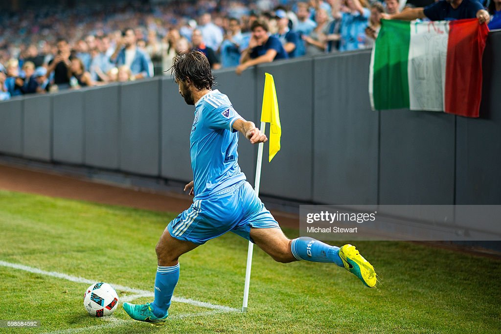 Midfielder Andrea Pirlo #21 of New York City FC takes a corner kick during the match vs D.C. United at Yankee Stadium on September 1, 2016 in New York City. New York City FC defeats D.C. United 3-2.