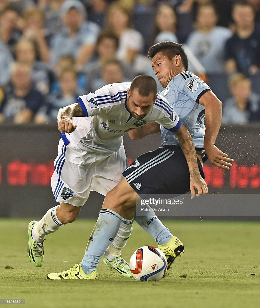 Mid-fielder Andres Romero # 15 of the Montreal Impact battles for the ball against mid-fielder Roger Espinoza #27 of Sporting Kansas City during the second half on July 18, 2015 at Sporting Park in Kansas City, Kansas.