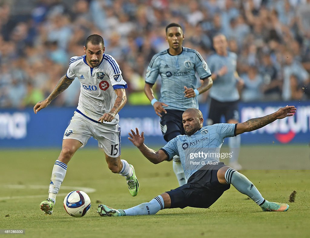 Mid-fielder Andres Romero #15 of the Montreal Impact dribbles past defender Kevin Ellis #4 of Sporting Kansas City during the first half on July 18, 2015 at Sporting Park in Kansas City, Kansas.