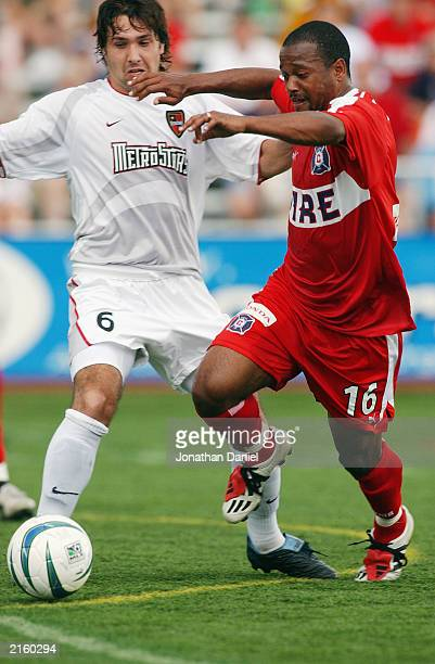Midfielder Andy Williams of the Chicago Fire pushes the ball upfield past defender Juan Forchetti of the NY/NJ MetroStars during an MLS game on June...