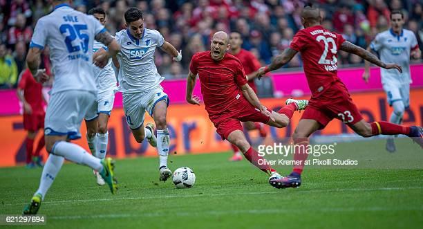 Midfielder Arjen Robben of Bayern Muenchen fouled by Defender Benjamin Huebner of 1899 Hoffenheim during the 1 Bundesliga match between FC Bayern...