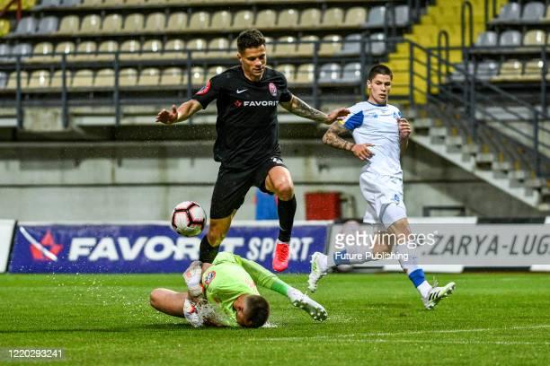 Midfielder Artem Hromov of FC Zorya Luhansk gets past a goalkeeper during a Ukrainian Premier League Matchday 26 game against FC Dynamo Kyiv at the...