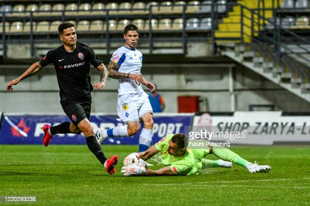 Midfielder Artem Hromov of FC Zorya Luhansk is seen in action with a goalkeeper during a Ukrainian Premier League Matchday 26 game against FC Dynamo...