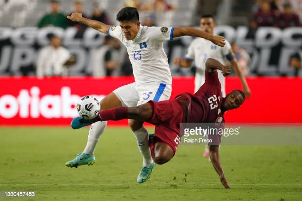 Midfielder Assim Madabo of Qatar challenges forward Marvin Marquez of El Salvador for the ball during the second half of the Concacaf Gold Cup...