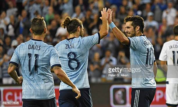 Midfielder Benny Feilhaber of Sporting Kansas City celebrates with teammate Graham Zusi after scoring a goal on a penalty kick against the Vancouver...