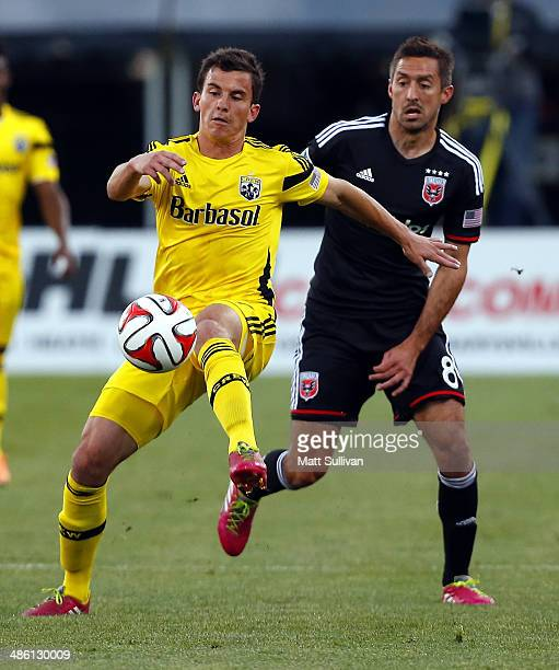 Midfielder Bernardo Anor of the Columbus Crew fights for the ball with midfielder Davy Arnaud of DC United during the first half of their game at...