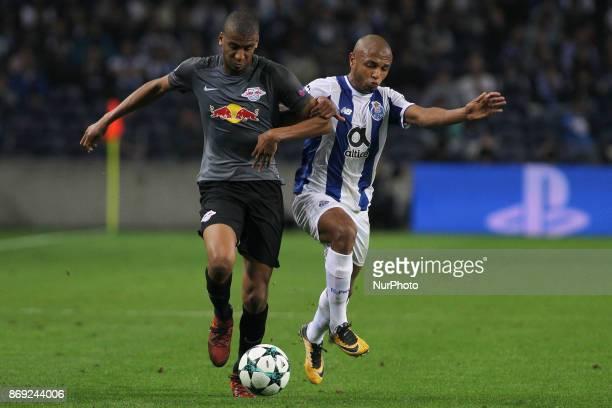 Midfielder Bernardo of Leipzig with Porto's Algerian forward Yacine Brahimi during the UEFA Champions League Group G match between FC Porto and...