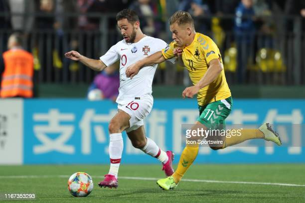 Midfielder Bernardo Silva of Portugal National Team and Forward Domantas Simkus of Lithuania National team battle for the ball during UEFA EURO 2020...
